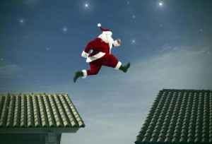 santa jumping from a roof to another in scottsdale